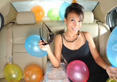 beautiful Asian female on way to party stock photo