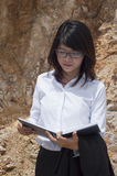 Beautiful Asian geologist woman. Royalty Free Stock Photos