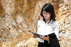 Beautiful Asian geologist woman. Royalty Free Stock Photography