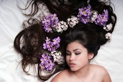 Beautiful asian girl. With flowers royalty free stock images