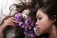 Beautiful asian girl. With flowers stock photography