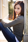 Beautiful asian girl. A portrait of a beautiful asian girl outdoor stock images