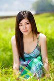 Beautiful asian girl. Beautiful young asian girl outdoors with lush greenery Royalty Free Stock Photos