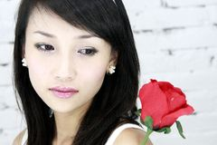 A beautiful Asian girl. A beautiful Asian girls and roses Stock Images