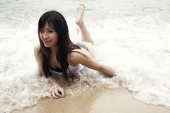 Beautiful Asian girl on the beach Stock Photography