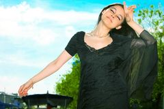 Beautiful Asian girl in a black dress Stock Images