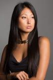 Beautiful Asian girl in a black dress stock photos