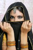 Beautiful asian girl with black veil on face. Beautiful brunette asian girl with black veil on face, traditional indian costume Stock Photo
