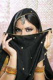 Beautiful asian girl with black veil on face. Beautiful brunette asian girl with black veil on face, traditional indian costume Stock Images