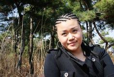 Beautiful Asian girl with braids Stock Image
