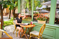 Beautiful asian girl in cafe Royalty Free Stock Image