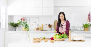 Beautiful Asian girl in casual dress is order fake fruit into wo royalty free stock photography