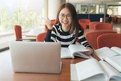 Beautiful Asian girl celebrate with laptop, Success or happy pose, Education or technology or startup business concept. Modern office or living room with copy royalty free stock photo