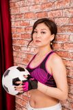 Beautiful Asian girl with a ball for playing football. Stock Photography