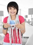 Beautiful asian girl with a cup of hot tea. In the room Royalty Free Stock Image
