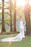 Beautiful Asian girl in a wedding dress showing happy moments royalty free stock photo