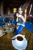 Beautiful Asian girl drinking tea Royalty Free Stock Photography
