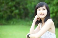 Beautiful Asian girl enjoying outdoors Stock Photography