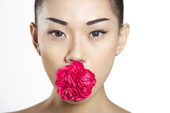 Beautiful Asian Girl with Flower Royalty Free Stock Images
