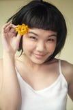 Beautiful Asian girl with flowers Stock Photos
