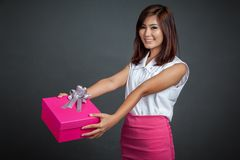 Beautiful Asian girl give a pink gift box Stock Image