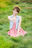 Beautiful asian girl on green meadow Royalty Free Stock Photos