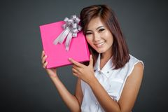 Beautiful Asian girl happy with a gift box Royalty Free Stock Images