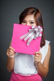 Beautiful Asian girl hold a gift box close her lower face Stock Photography