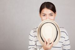 Beautiful Asian girl hold  a  hat close her mouth Stock Image
