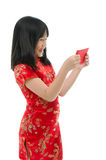 Beautiful asian girl holding ang pow or red packet monetary gift Royalty Free Stock Images