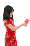 Beautiful asian girl holding ang pow or red packet monetary gift Royalty Free Stock Photo