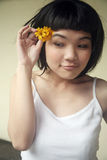 Beautiful Asian girl holding flowers Royalty Free Stock Photography