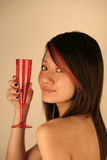 Beautiful Asian girl holding a glass Stock Photos