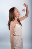 Beautiful asian girl  holding a lollipop with joy. Royalty Free Stock Photo