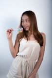Beautiful asian girl  holding a lollipop with joy. Stock Photos