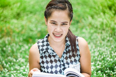 Beautiful asian girl holding an open book Royalty Free Stock Images