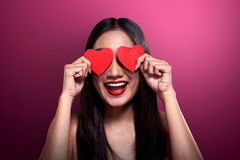 Beautiful asian girl holding red heart cover her eyes Stock Images