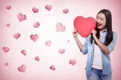 Beautiful asian girl holding red heart Stock Image