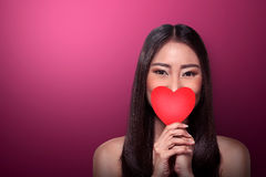 Beautiful asian girl holding red heart Stock Images