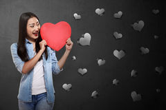 Beautiful asian girl holding red heart Stock Photography