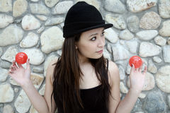 Beautiful Asian girl holding two balls Royalty Free Stock Photography