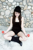Beautiful Asian girl holding two balls Stock Photo