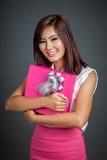 Beautiful Asian girl hug a gift box Royalty Free Stock Photos