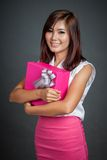 Beautiful Asian girl hug a gift box and smile Royalty Free Stock Photography