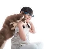 Beautiful asian girl hugging siberian husky puppy on white backg Stock Photos
