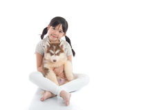 Beautiful asian girl hugging siberian husky puppy on white backg Stock Image