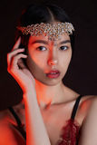 Beautiful asian girl with jewelry. Sensual beauty woman in underwear.colored spotlights portrait. beautiful asian girl with jewelry stock image