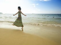 Beautiful asian girl jumping on the beach Stock Images
