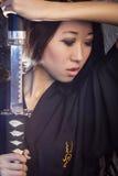 Beautiful Asian girl in kimono with a katana Stock Photos