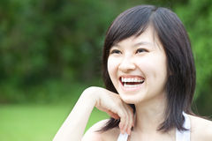 Beautiful Asian girl laughing outdoors Royalty Free Stock Images